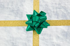 Snow gift with golden ribbon Royalty Free Stock Photo