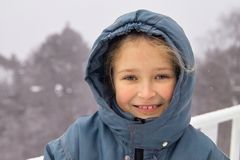 Snow girl. Portrait of a young girl in snow Stock Images