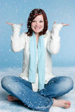 Snow Girl. Beautiful girl playing in falling snow stock image