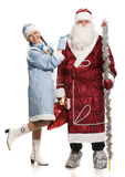 Snow girl  embraces Santa Stock Images