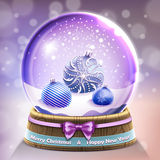 Snow glass crystal ball with christmas balls Royalty Free Stock Image