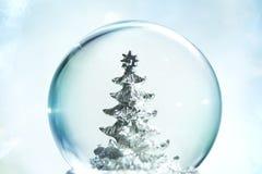 Snow globe. With Christmas tree Royalty Free Stock Photos