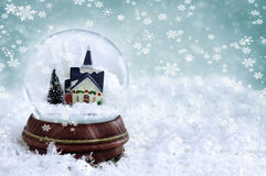 Snow Globe. With church and christmas trees inside. Copy space available royalty free stock photography
