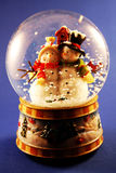 Snow Globe. A traditional snow globe on blue stock image