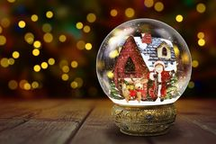 Snow Globe Against Christmas Lights Background