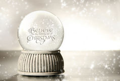 Snow globe against  silver Royalty Free Stock Images