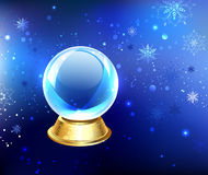 Snow globe on a blue background Stock Photo