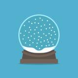Snow globe on blue Stock Photos
