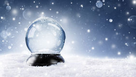 Snow Globe - Christmas Magic Ball. On The Snow royalty free stock image