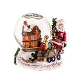 Snow globe. A christmas themed snow globe with a house and a santa figurine isolated over white Royalty Free Stock Image
