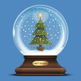 Snow globe with a Christmas tree inside. Glass sphere with snowflakes and Christmas tree inside. Snow globe on a wooden stand with metal sign. Xmas design Stock Photo