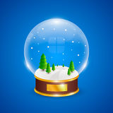 Snow globe with christmas trees on blue background Stock Images