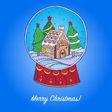 Snow globe with christmas trees and gingerbread house inside Stock Images
