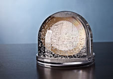 Snow globe with coin Stock Photo