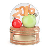 Snow globe with 2016 digits and christmas bauble. Isolated on white background. 3d render Royalty Free Stock Image