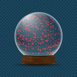 Snow globe with falling hearts Stock Image