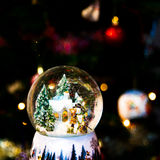 Snow globe in front of Christmas tree