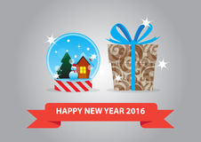 Snow globe and gift box. For new year 2016 Stock Photography