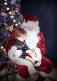 Snow Globe Glow. Santa Showing child magic glowing snowglobe royalty free stock image