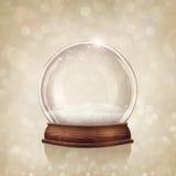 Snow globe. On a golden background Stock Photos