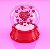 Snow globe with hearts on pink background stock photo