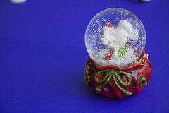 Snow globe with horse. Over blue background Stock Images