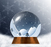 Snow globe with miniature winter landscape scene inside Stock Images