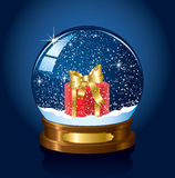 Snow globe with Present Stock Photography