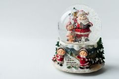 Snow globe with Santa Claus inside Stock Photos
