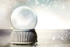 Snow globe with silver stars Royalty Free Stock Photos