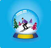 Snow globe skier stock photography