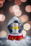Snow Globe. With snowman over christmas lights background Stock Photos
