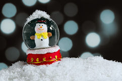 Snow Globe. With snowman over christmas lights background royalty free stock photography