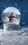 Snow globe in a snowy winter scene Royalty Free Stock Image
