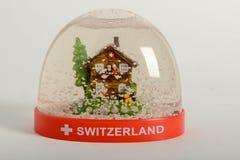 Snow globe of Switzerland. On white background stock photo