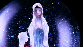 Snow globe. With the Virgin Mary stock video footage
