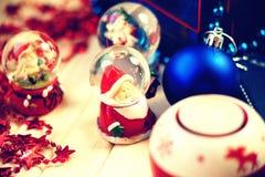 Snow globes and christmas balls. Snow globes, red stars and christmas balls Stock Images