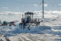Snow grader in action royalty free stock images