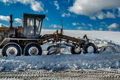 Snow grader Stock Images