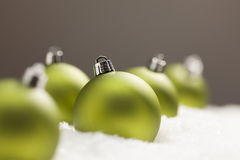 Snow with Green Christmas Ornaments with Text Room Royalty Free Stock Images