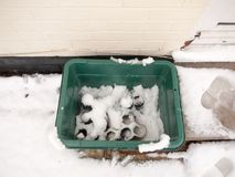 Snow on green plastic box bin outside recycling Stock Photography