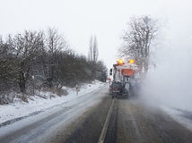 Snow gritter sprinkle salt on the road Stock Image