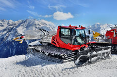 Snow Groomer in Alps. Snow groomer in Otztal Alps in Austria near Solden ski resort Stock Photo