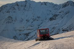 Groomer. Snow groomer while he beats the ski track Royalty Free Stock Image