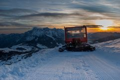 Groomer. Snow groomer while he beats the ski track Royalty Free Stock Images