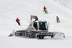 Snow groomer. FLACHAU, AUSTRIA - JAN 7: Snow groomer on the ski piste in the ski resort town of Flachau, Austria on Jan 7, 2012. These pistes are part of the Ski Stock Photos