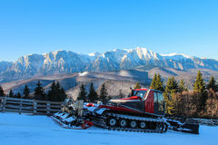 Snow Groomer and Mountain Landscape Stock Photography