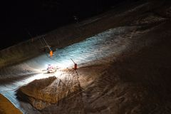 Snow groomer at night Royalty Free Stock Photography
