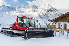 Snow Groomer Outside a Mountain Restaurant Royalty Free Stock Photos