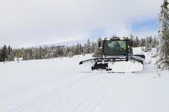 Snow groomer prepares ski cross-country route, ski track on fre stock image